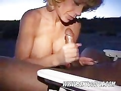 Interracial BJ exceeding the beach