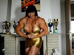 Massive big tittied muscle queen Jana flexes in tight auriferous dress