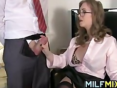MILF Giving A Handjob At The Office