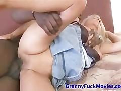 Granny having fun with huge black cock