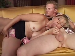 Mature couple move forward crazy on their sofa