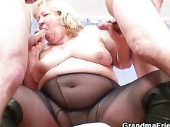 Big grandma pleases two cocks