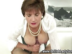 Busty mature Lady Sonia gives handjob