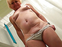 Ugly Frightening Blonde Oldie Takes A Shower Added to Teases Her Mature Cunt