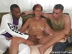 Beauteous granny gets slammed by two dicks