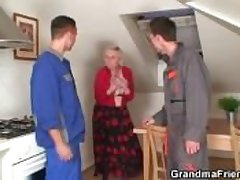Several repairmen burgeoning gaffer grandma from both ends