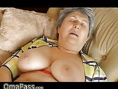 Granny with big pendulous tits masturbating on the siamoise