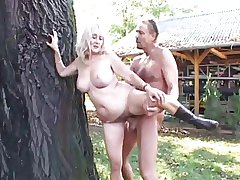 blonde granny is being fucked outdoor