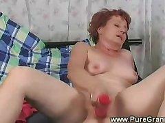 Lubricious granny masturbates