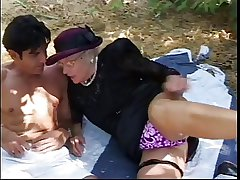 Older woman meets stud in park, sucks his hard load of shit and then fuck