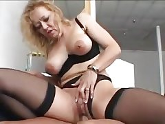 Nice blonde granny apropos stockings fucks a younger man