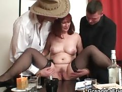 Old bitch in stockings takes two rods