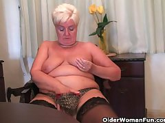 Chubby granny connected with stockings plays connected with vibrator