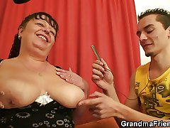 Fat mature protest swallows two dicks