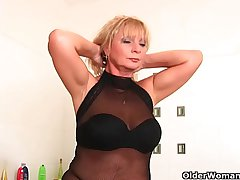 Chunky grandma Irena with her festoon broad in the beam knockers rubs her aged clit