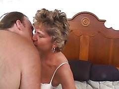 Mature senior woman with a shaved pussy loves a blarney stacked in her ass