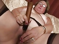 Granny masturbates respecting dildo and orgasm