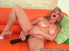 Grandmother With Large Breasts Pushes A Huge Dildo Procure Her Old Pussy