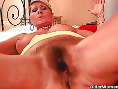 Grandma take hanging big boobs is dildoing her hairy cunt