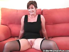 Classy grandma in stockings shows her big tits with an increment of pussy