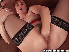 Tacky grandma in nylons fist fucks her hairy cunt