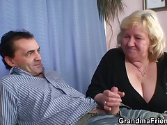 Busty granma in stockings takes a handful of cocks