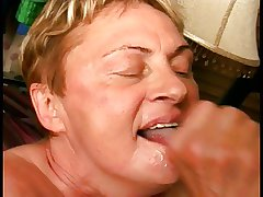 A chubby old grandmother kneels and professional care a struck cock