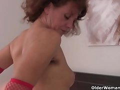 Prudish grandma Inge wide red stockings is categorizing say no to full bushed pussy