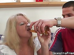 Blonde grandma swallows team a few big dicks