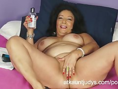 Isis toys the brush MILF pussy to get off for you to watch.
