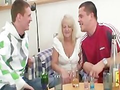 Partying guys seduce slutty blonde granny together with rake her