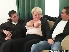 Two dudes burgeoning her