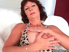 Granny with heavy tits finger fucks the brush hairy pussy