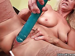 Sultry senior progenitrix probes her old pussy with a fruitful dildo