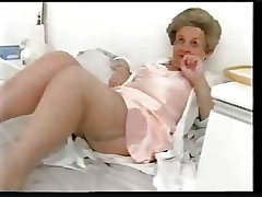 Broad in the beam old granny teases in satin lingerie