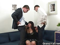 Two dudes are banging giving titted mature bitch