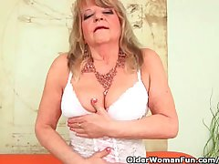 Grandmother With Large Breasts Pushes A Huge Dildo Earn Her Old Pussy