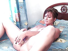 Classy grandma pushes dildo up will not hear of ass