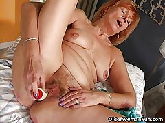 Redheaded granny Susan fucks the brush hairy pussy with a dildo