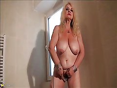 Granny Dana (66) strips and masturbates