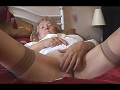 Blonde Granny in stockings posing and chaff