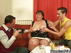 Fat hooker takes two cocks