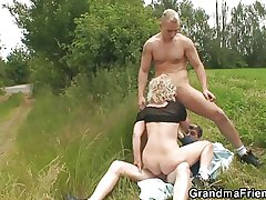 Aged whore takes four dicks outdoor