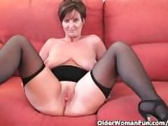 Swank granny beside stockings shows absent her beamy tits coupled with fuckable pussy