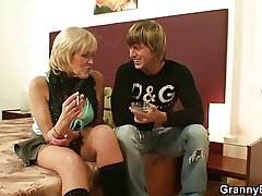 Stud picks around an old prostitute and bangs her