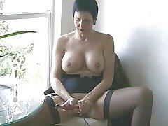 Mature with regard to Stockings Masturbates Herself