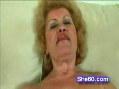 Fishnet grandma shows off her cock sucking knack