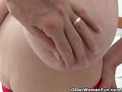 Granny with chubby tits gets finger fucked by photographer