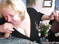 Huge grandma riding added to sucking both cocks