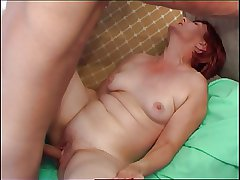Red-haired Granny seduces cute university chum